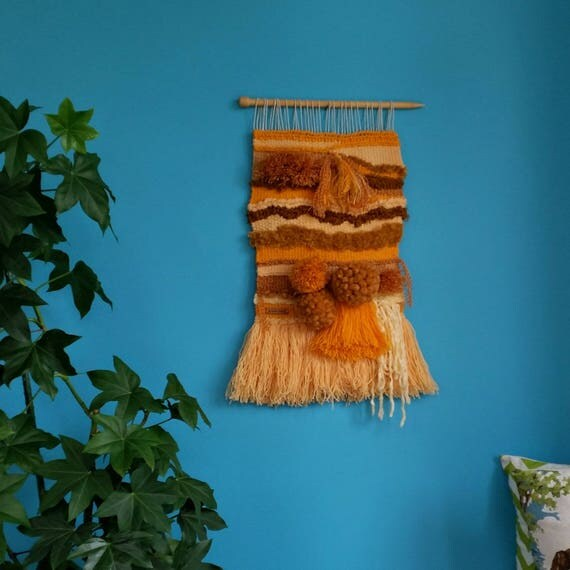 Mustard woven wall hanging.