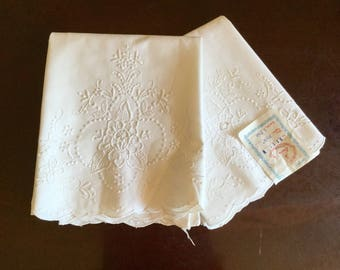 Pair of vintage New Old Stock cotton Pillowcases white embroidery