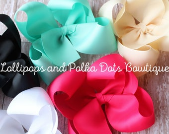"""Set of 6 6"""" solid twisted boutique bows"""