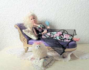 Barbie Doll Reclining on Chaise Lounge Chair with her adorable kitten.