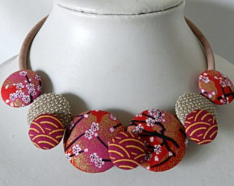 Necklace in red and fuchsia Japanese fabrics, on natural cork cord