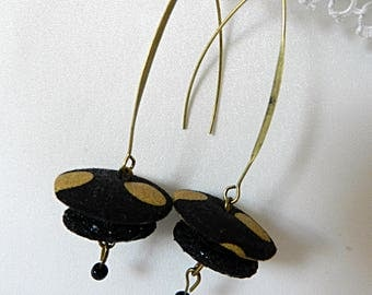 Earrings in black fabric with golden polka dots
