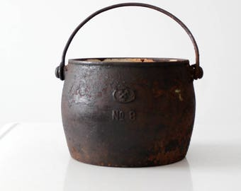 antique cast iron pot with bail handles
