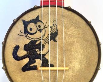 Vintage hot rod red Richter BANJO UKULELE banjolele Uke with Felix the Cat painted on it Regal pre war