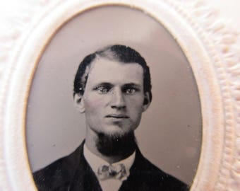 antique tintype with paper frame - young man, rosy cheeks, beard