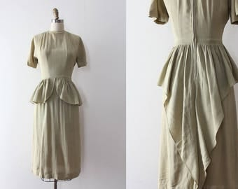 vintage 1940s dress // 40s pale green peplum dress