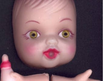 Doll face and arms vintage 1960s Craft supply from Kleenex mail order