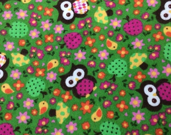 Owls on green cotton flannel fabric