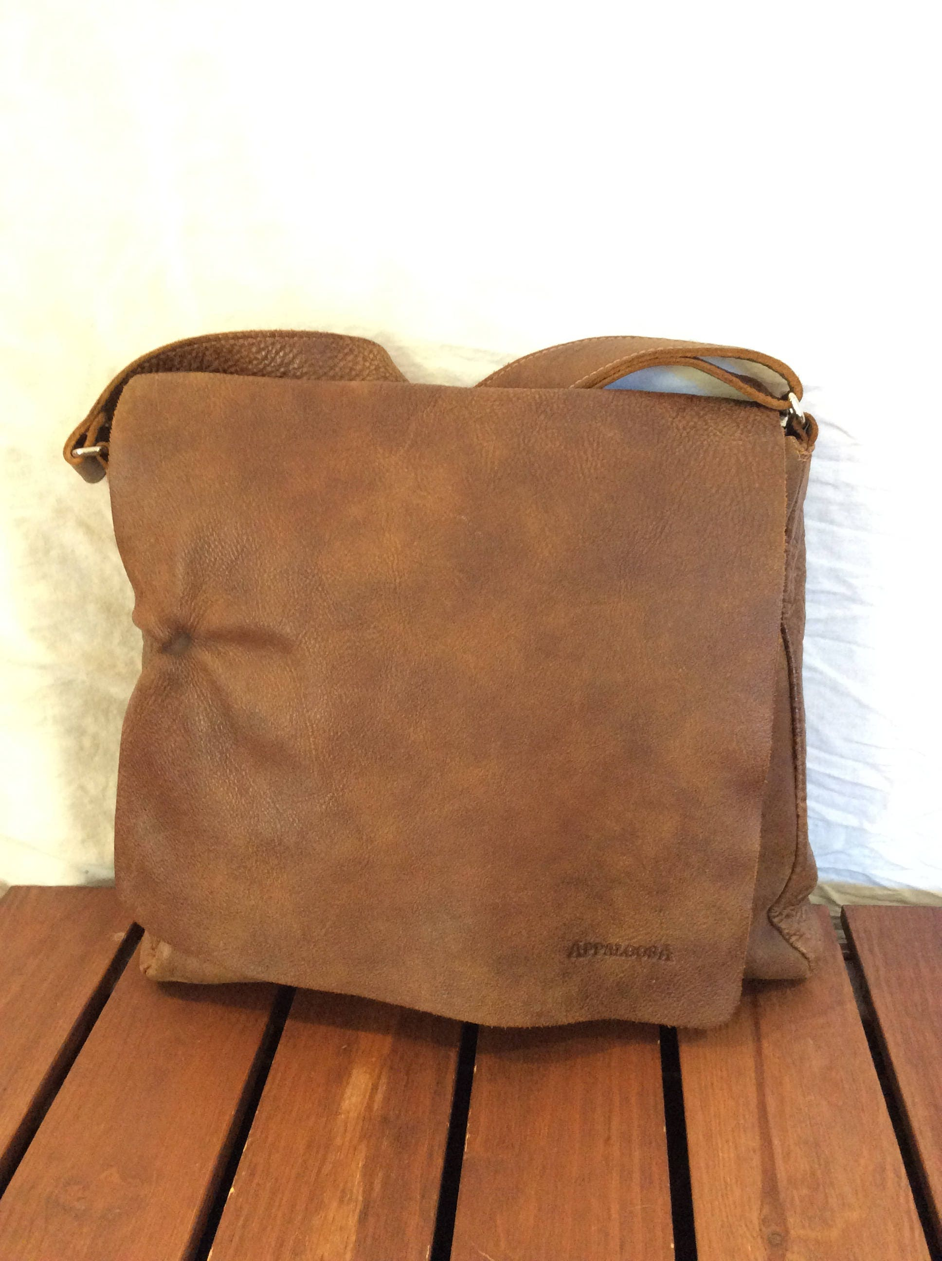 to find vintage genuine roots brown leather crossbody