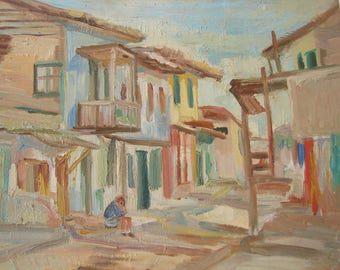 antique,signed Greek oil painting on wood-child, boy sitting on pavement, street kerb, Greek island, houses washing.