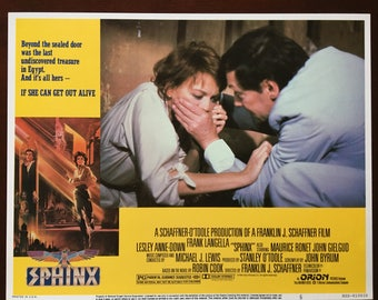 Lobby card for movie Sphinx with Frank Langella and Lesley Anne Down.