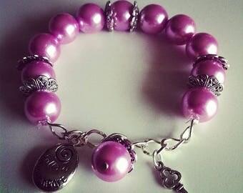 #76 purple charm bracelet