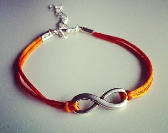 Orange cord bracelet with silver infinity sign