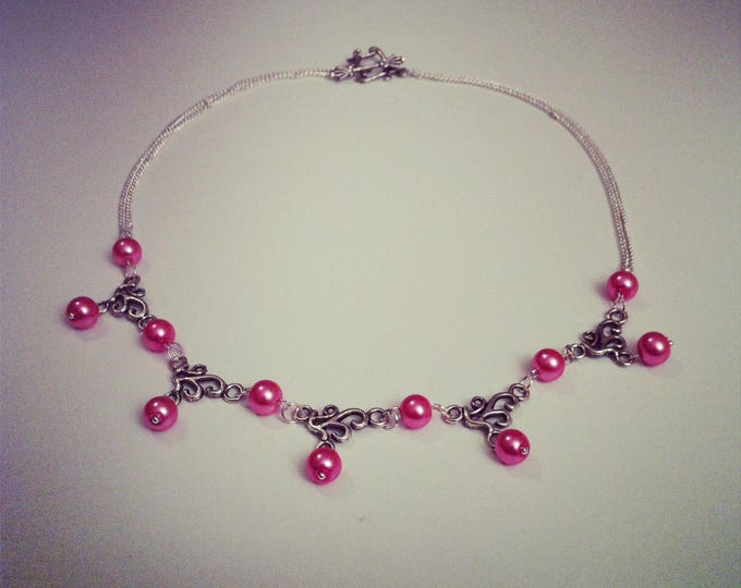 Necklace pink beads and silver arabesques
