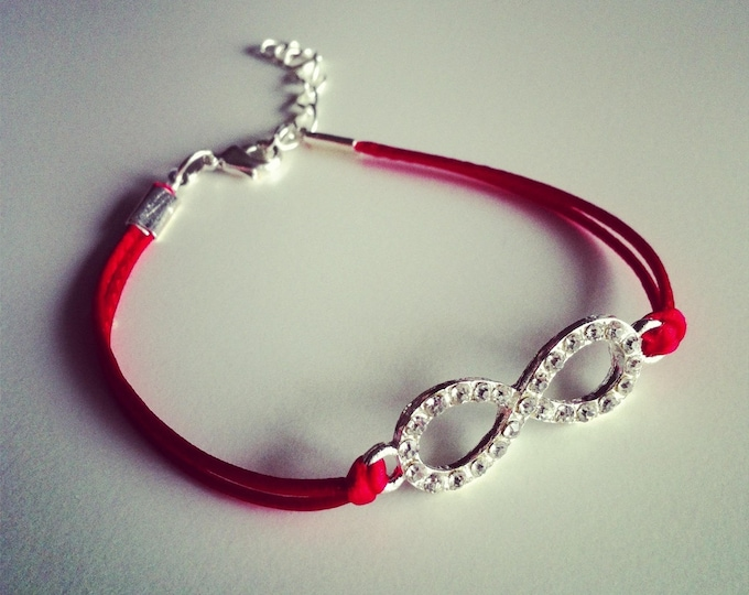 Red cord with sign bracelet infinity strass