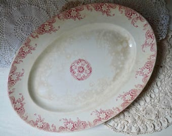 1 Antique OVAL SERVING PLATE, Tea Stained Ceramic Plate with Red Floral Border. Stamped U & Cie Sarreguemines. Print: Lerida, 1900.