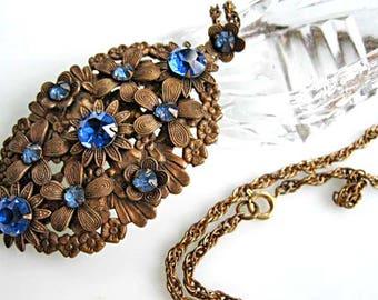 Czech Flowers Pendant, Blue Glass Stones, Brass Florals on Large Filigree Oval Drop, Prongset Stones, 24 Inch Brass Chain