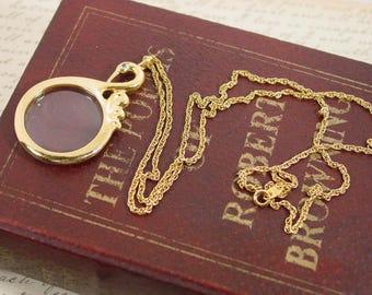 "Avon ""Graceful Swan Magnifying Glass Pendant"" Gold Tone with Blue Rhinestone Eye - Vintage 1994"