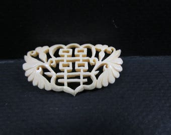 Asian hand carved brooch