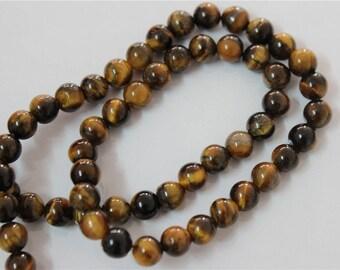 65 pearls 6mm Tiger eye stone