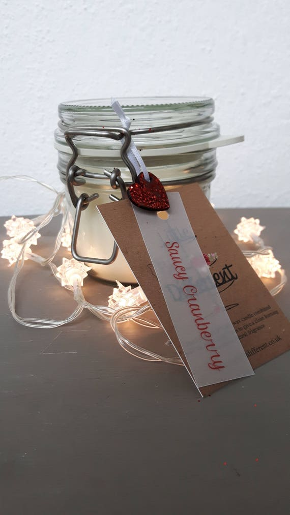 Saucy Cranberry scented, eco friendly, vegan soy wax candles in reusable Kilner style jars.