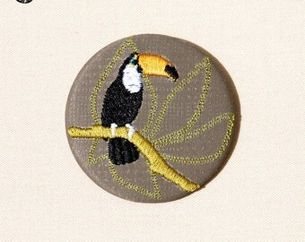 Large embroidered brooch in a tree tropical toucan bird