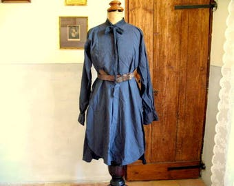 Antique French cotton shirt dress dyed inky blue, lots or darns and patches 55 euro.