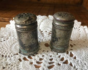 Antique glass and silverplated salt and pepper shakers. Heavy!