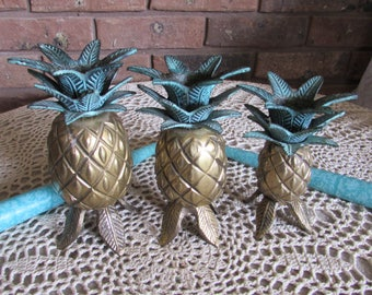 Set of Three Brass Pineapple Candle Holders India.