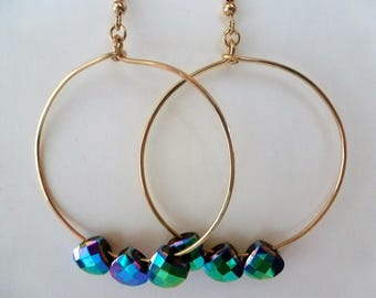 Rainbow Crystal Earrings are 2 inch gold hoops, each embellished with a trio of rainbow checker-faceted crystal briolettes.