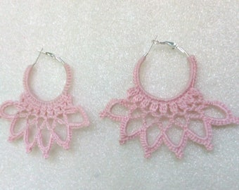 pink crocheted earrings in the form of rings