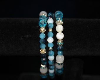 Blue, white, and silver- three-set elastic bracelet