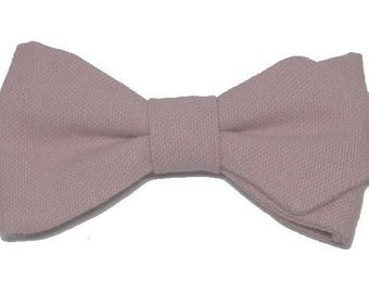 Pink old bowtie with sharp edges