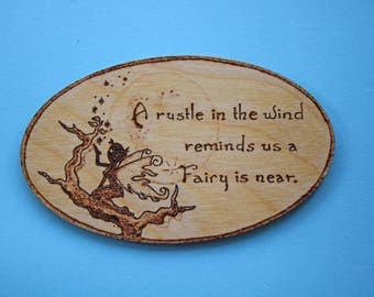 A rustle in the wind reminds us a Fairy is near oval fridge magnet