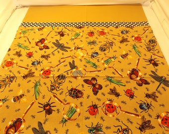 Brown pillowcase with bugs.