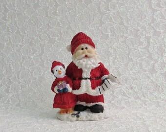 Santa Clause with Penguin Christmas Figurine