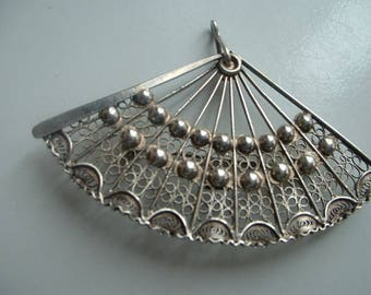 Ornate silver fan brooch