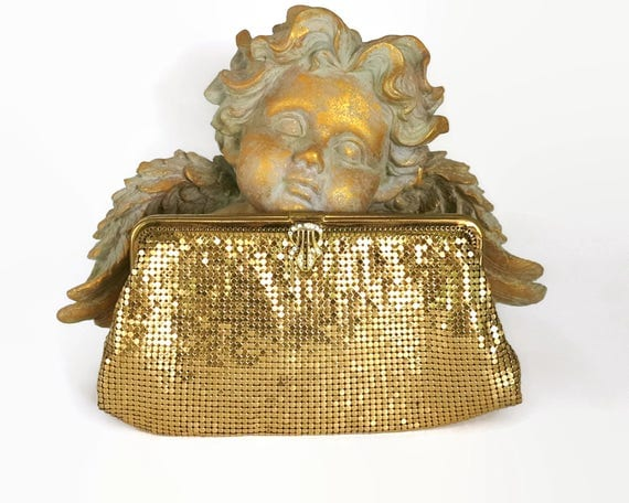 Vintage gold mesh clutch purse with rhinestone clasp and gold metal frame, beautiful gold color, circa 1970s