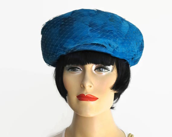 Vintage blue feather hat with deep turned up brim, blue net, blue satin bow, fully lined, gorgeous color, open size, mid 20th century