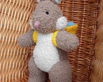 Easter Bunny with his basket of knitted easter eggs on his back is designed by Alan Dart