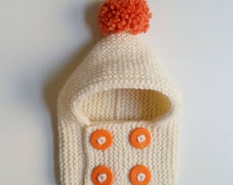 Hat(Cap) cowl for born babies in 24 years hand-knitted woolen ecru with orange buttons and pompom