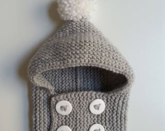 Hat for woolen hand-knitted baby from 0 to 2 years old intoxicates with white buttons and pompom