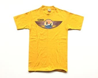 1980s FLORIDA SURFING Sets athletic wear 50/50 t shirt size small single stitch vibrant yellow