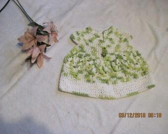 green and white baby girls dress