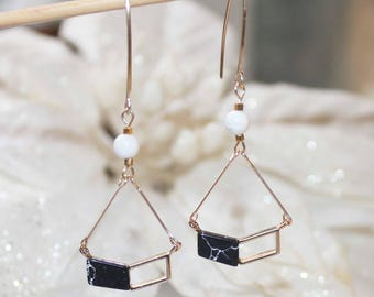 Fine gold plated earrings with howlite stones