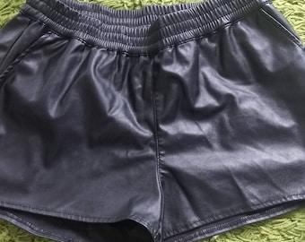 Black faux leather shorts