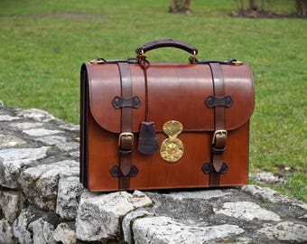 Hand dyed veg tan leather briefcase.