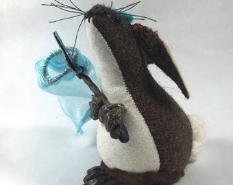 Small 3d fabric bunny with butterfly net