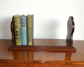 Original English antique Victorian mahogany folding book rack holder stand with brass lion head mounts c.1880
