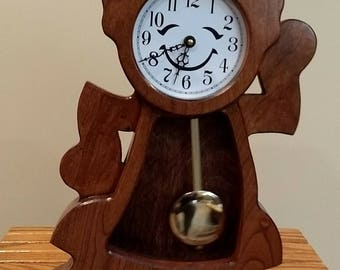 Clock: (it's a girl)These whimsical clocks would be a very nice addition to your child's bedroom or your mantle.